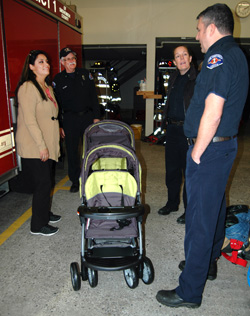 Firefighters donate stroller to mom