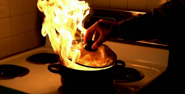 putting a lid on a fiery stovetop skillet