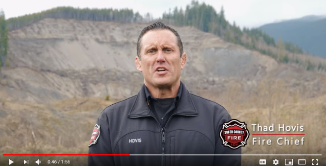 Fire Chief Hovis with Oso landslide in background