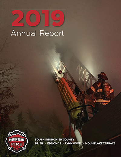 2019 Annual Report cover of aerial ladder at a fire