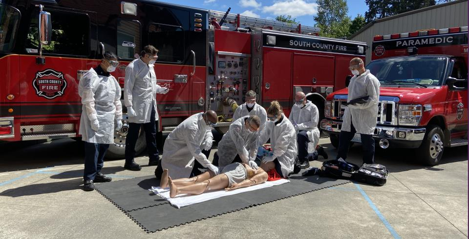 Firefighters perform high-performance CPR in full PPE